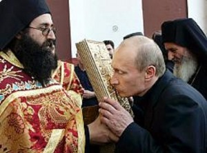 Russian President Vladimir Putin kisses an icon while visiting the Mount Athos monastic community in northern Greece, during a visit, Friday, Sept. 9 2005. Putin made a private pilgrimage Friday to the 1,000-year-old monastic community of Mount Athos, the first Russian head of state ever to set foot in a place regarded as the cradle of Orthodox Christianity. (AP Photo/ITAR-TASS, Presidential Press Service, Vladimir Rodionov)